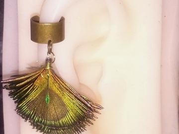 Vente au détail: Bague d'oreille simple bronze plume de paon (plusieurs modèles di