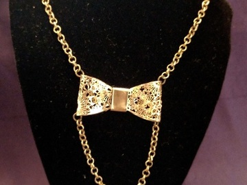 Vente au détail: Collier chaine noeud ajouré doré