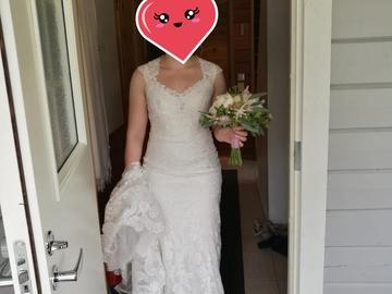 Ilmoitus: Allure Bridals-merkin hääpuku