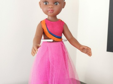 For Sale: Black doll with pink outfit