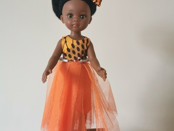 For Sale: Black doll with orange outfit