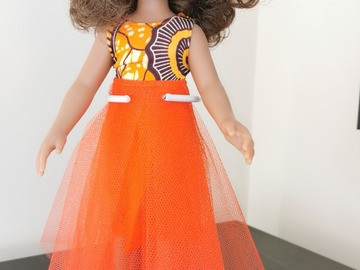 For Sale: Mixed race doll with orange outfit