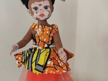 For Sale: Vitiligo doll with orange outfit