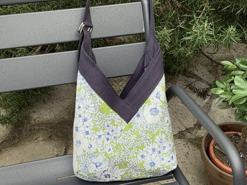 : Small organic blue bag and green flowers by Yvonne & Annette
