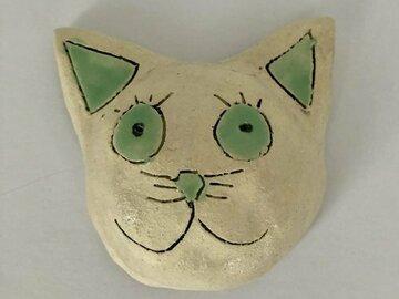 Myydään tavaraa tai tarvikkeita: Kissa, Vihreä