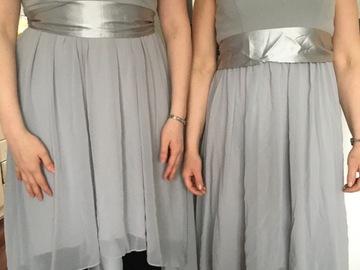 Ilmoitus: Kaksi harmaata mekkoa