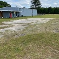 Book Your Stay: Parking Lot beside a warehouse (home) Erwin NC