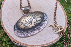 Selling: Swirly Brass and Textured Copper Necklace