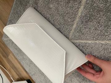 Ilmoitus: Valkoinen laukku