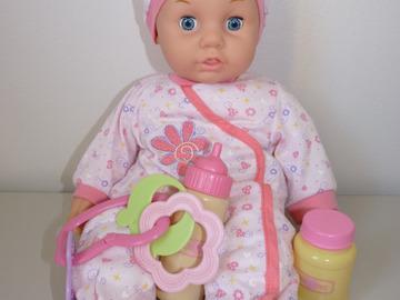 Vente: Poupon yeux bleus 40 cm avec vêtements de rechange TBE