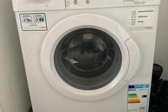 À vendre: Machine à laver à réparer