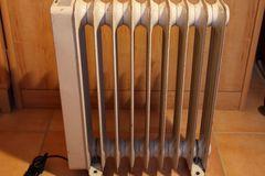 Location: Chauffage radiateur Bain d'huile éléctrique