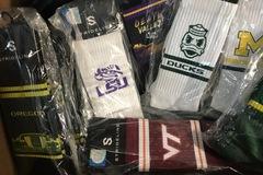 Liquidation/Wholesale Lot: NCAA Crew team socks 34 pair various teams Strideline
