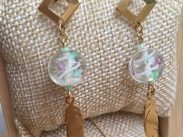 Sale retail: Boucles d'oreilles pendantes acier inoxydable et plume