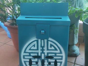 : Mailbox : Longevity white and silver on turquoise background